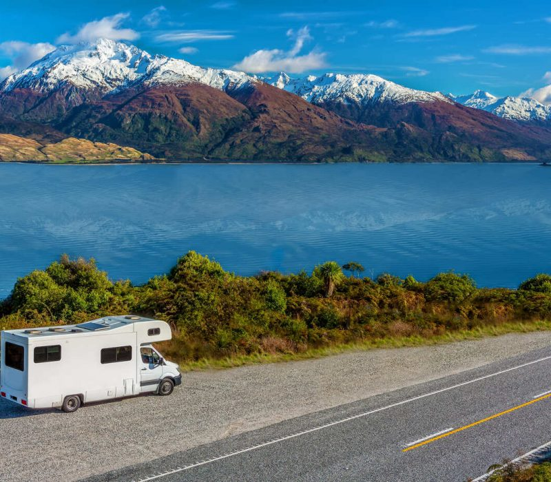 an-rv-next-to-lake-wanaka-viewpoint-with-snow-capped-mountains-in-the-distance (1) (1) (1)